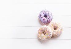 Trzy donuts z przestrzenią dla teksta Fotografia Stock