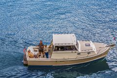 Trzy faceta na łodzi Zdjęcie Royalty Free