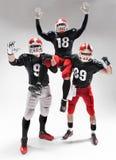 Trzy futbolu amerykańskiego gracza pozuje na białym tle Zdjęcia Royalty Free