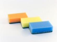 Trzy gąbki dla myć naczynia na białym tle Obraz Stock