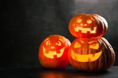 Trzy Halloween Jack O ` lampionu bani Obraz Stock