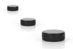 Trzy hokejowy krążek hokojowy Obrazy Royalty Free