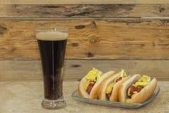 Trzy hot dog i kola napój Fotografia Royalty Free