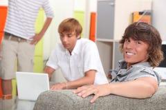 Trzy housemates męski relaksować Zdjęcia Stock