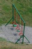 Trzy huśtawki w boisku Obrazy Stock
