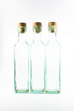 trzy isoladed butelki opróżnione Zdjęcie Royalty Free