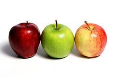 Trzy jabłka Na bielu Fotografia Stock