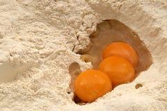Jajeczni yolks w mące Zdjęcie Stock