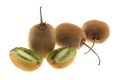 Trzy kiwi owoc i pokrajać jeden kiwi Zdjęcia Royalty Free