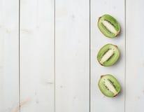 Trzy kiwifruit połówek skład Obraz Stock