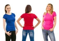 Trzy kobiety z pustymi koszula fotografia stock