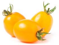 Trzy kolorów żółtych pomidor odizolowywający na białym tle Obrazy Stock