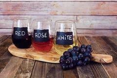 Trzy kolorów wina lot w etykietek szkłach Obrazy Royalty Free