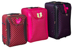 Trzy Kolorowej walizki Zdjęcie Stock