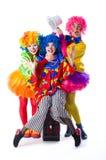 Trzy kolorowy śmieszny błazen na białym tle Zdjęcia Royalty Free