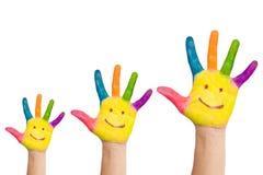 Trzy kolorowych ręki z uśmiechem rodzina Zdjęcia Royalty Free