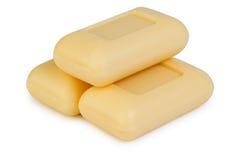 Trzy koloru żółtego mydło Obrazy Stock