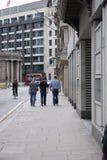 Trzy mężczyzna chodzić Obrazy Royalty Free