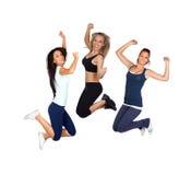 Trzy młodych dziewczyn skakać odizolowywam Obrazy Royalty Free