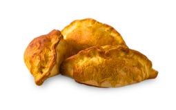 Trzy Małego kulebiaka z faszerować pn bielu tło Zdjęcie Stock