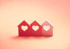 Trzy małego domu z sercem Zdjęcia Royalty Free