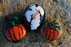 Trzy malowali małe skały dla Halloween Fotografia Stock