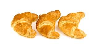 Trzy masła croissant odizolowywający na białym tle Zdjęcia Stock