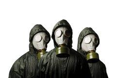 Trzy maski gazowej odizolowywającej na białym tle Przetrwanie temat obrazy stock
