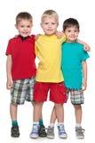 Trzy moda uśmiecha się małych przyjaciół fotografia royalty free