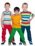 Trzy one uśmiechają się małego przyjaciela zdjęcie royalty free