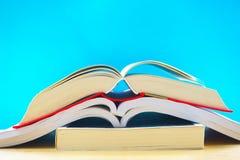Trzy otwierającej książki w błękitnym tle Zdjęcie Royalty Free