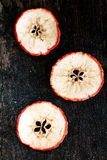 Trzy Owocowego plasterka na stole Obraz Stock