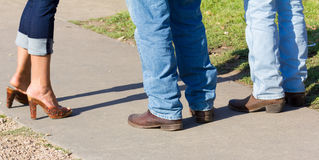 Trzy pary buty i cajgi Fotografia Royalty Free