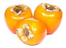 Trzy persimmons, biały tło Obraz Royalty Free