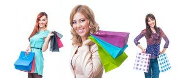 Trzy pięknej młodej kobiety z torba na zakupy Zdjęcia Stock
