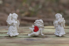 Trzy porcelana amorków figurka Zdjęcie Stock