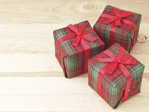 Trzy prezent na drewnie Zdjęcie Stock