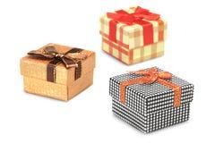 Trzy prezenta pudełka odizolowywającego na białym tle Obrazy Royalty Free