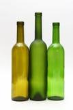 Trzy pustej butelki wino na białym tle Zdjęcie Royalty Free
