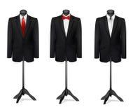 Trzy różnego kostiumu na mannequins Obrazy Royalty Free