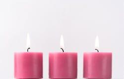 trzy różowią świece. Obraz Stock