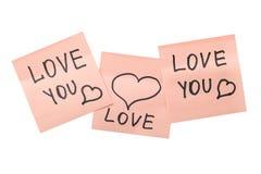 Trzy różowej kleistej notatki z sercami Zdjęcie Stock