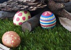 Trzy ręka malującego Easter jajka Zdjęcia Stock