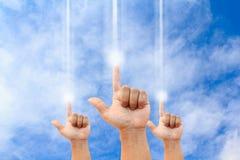 Trzy ręka wskazująca wewnątrz jasny niebieskie niebo Zdjęcie Stock