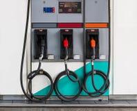 Trzy refuel nozzles w benzynowej staci Obraz Royalty Free