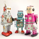 Trzy retro zabawkarskiego robota wpólnie Obrazy Royalty Free
