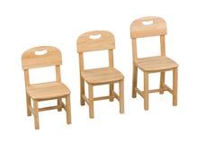 Trzy rozmiar krzesła dla dzieciaków Fotografia Stock