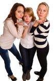 Trzy seksownej dziewczyny dmucha buziaka fotografia stock