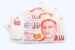 Trzy Singapur dziesięć dolarowych banknotów Zdjęcia Stock