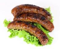 Trzy smakowita piec na grillu kiełbasa Obraz Royalty Free